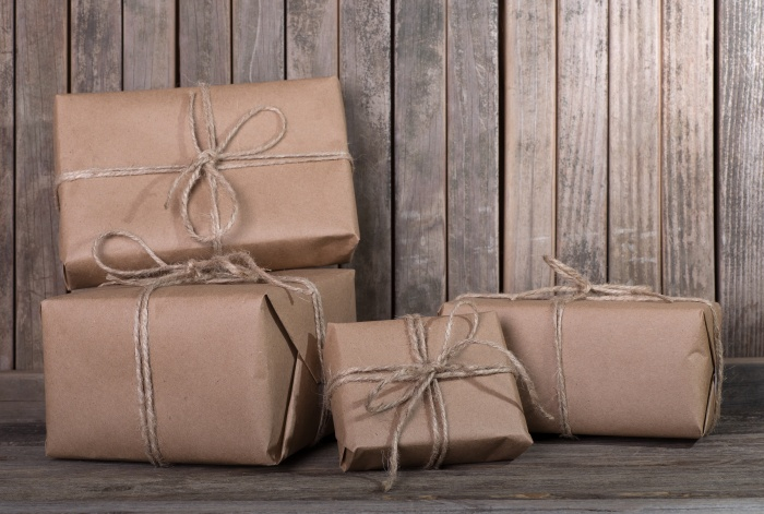 Several brown wrapped packages on a wood background
